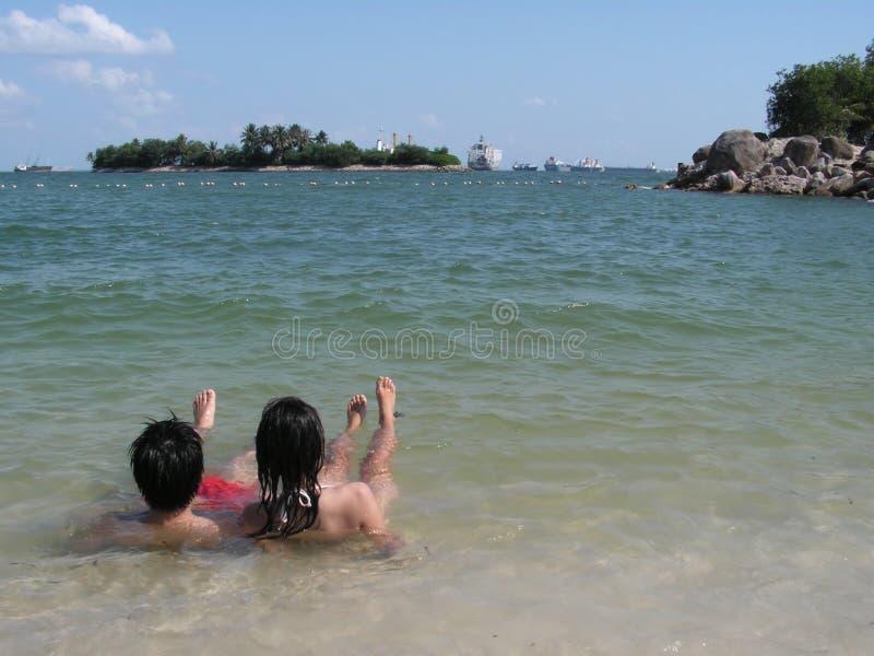 Young couple in the sea stock photos