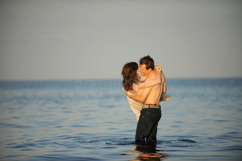 Download Young couple in the sea stock image. Image of holding - 22800067
