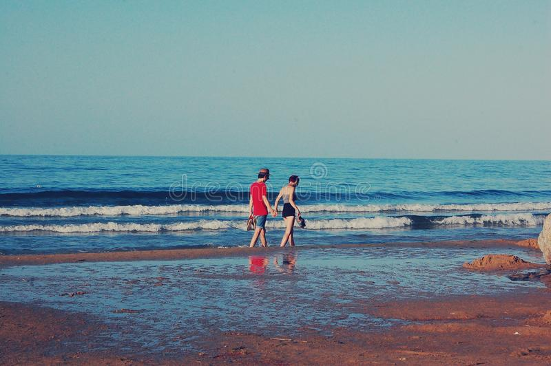 Young couple on the sea shore stock photo