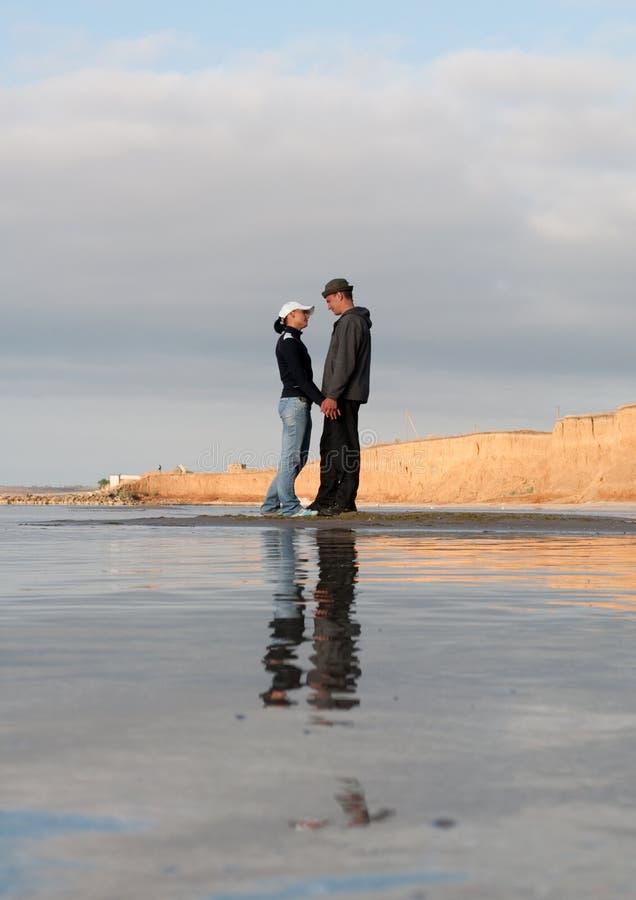Young couple at the seashore royalty free stock photos