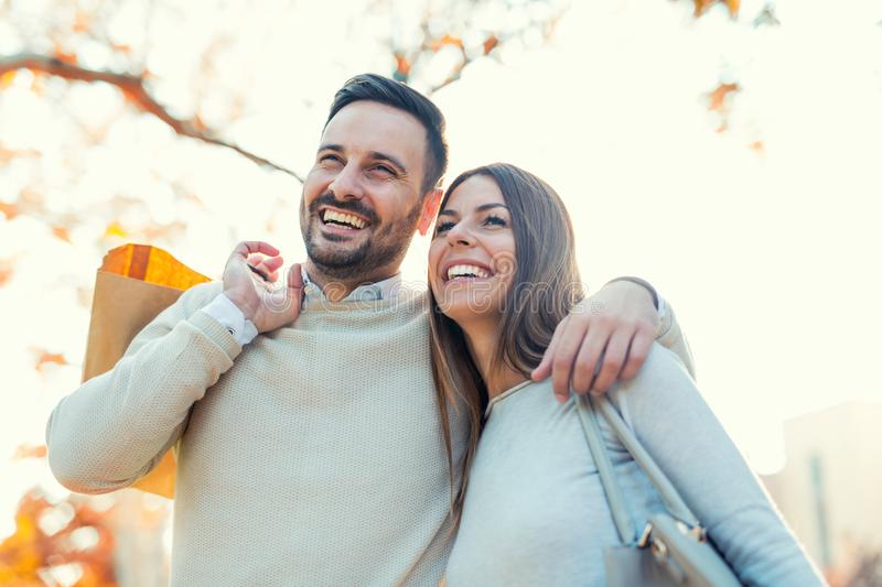 Young couple with shopping bags stock image