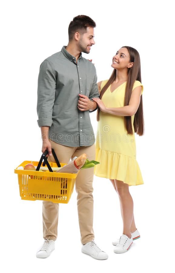 Young couple with shopping  full of products isolated on white stock images