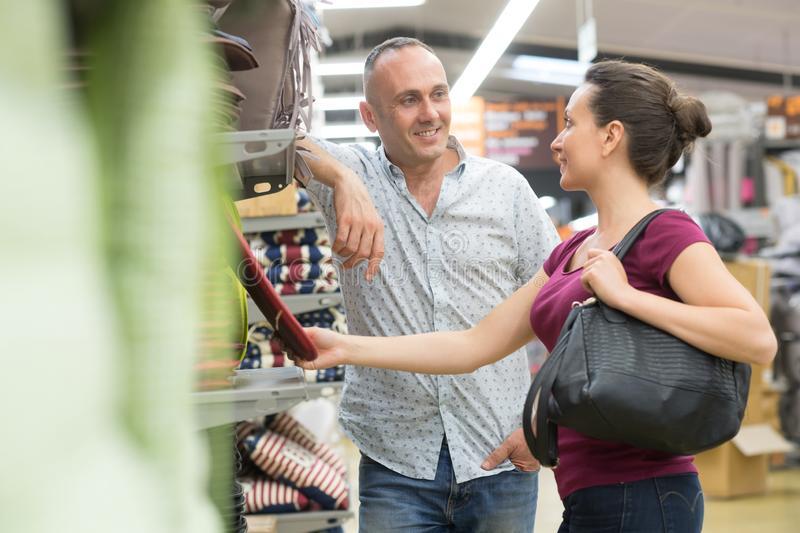 Young couple shopping for diy tools at hardware store royalty free stock photography
