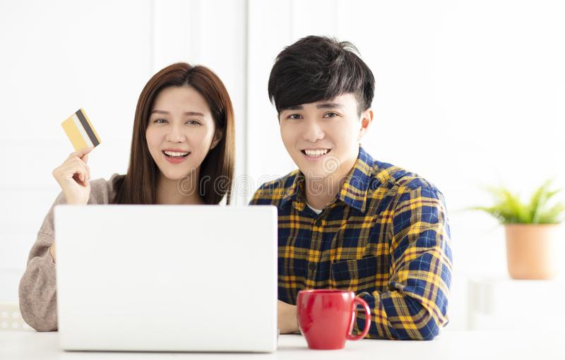 Young couple  shopping online by laptop. Happy young couple  shopping online by laptop royalty free stock photos
