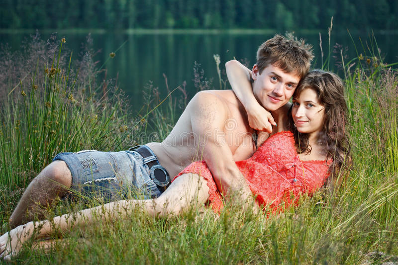 Download Young couple on the shore stock photo. Image of summer - 25579466
