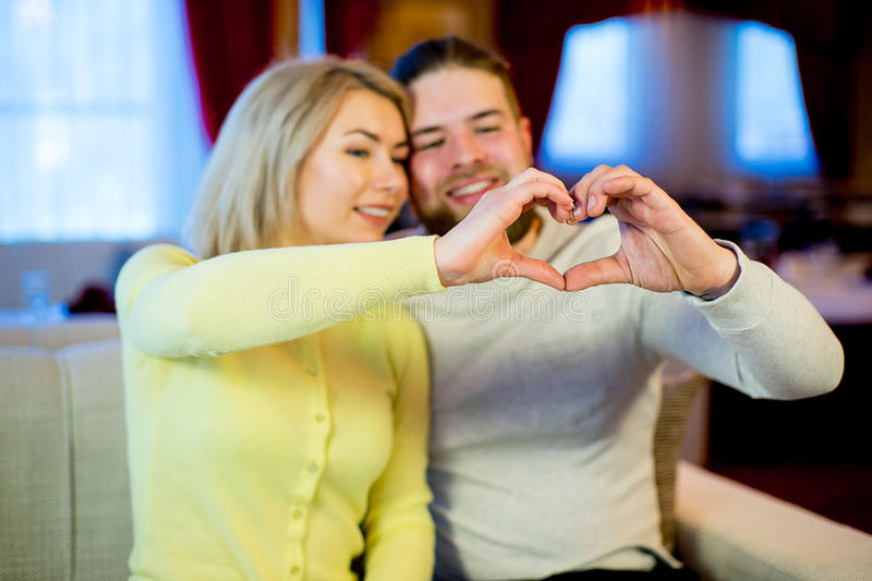 Young couple showing hands heart royalty free stock image