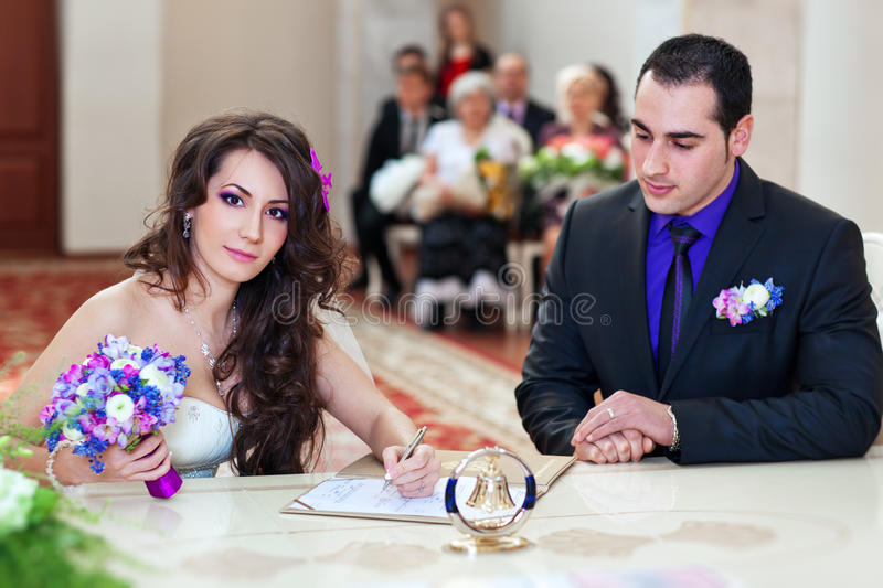 Download Young couple signing stock image. Image of white, beauty - 26971327