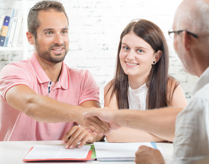 A young couple signs a contract royalty free stock photo