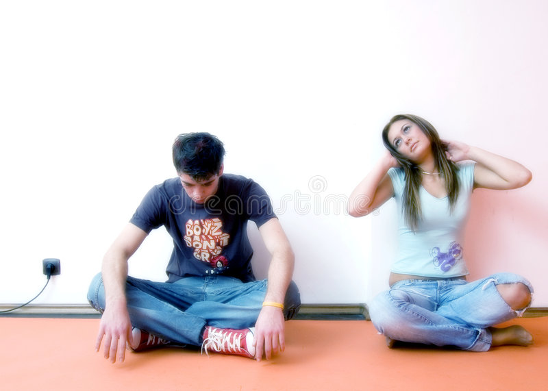 Young Couple Sitting royalty free stock images