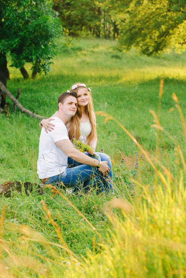 Young couple sitting close to each other royalty free stock photography