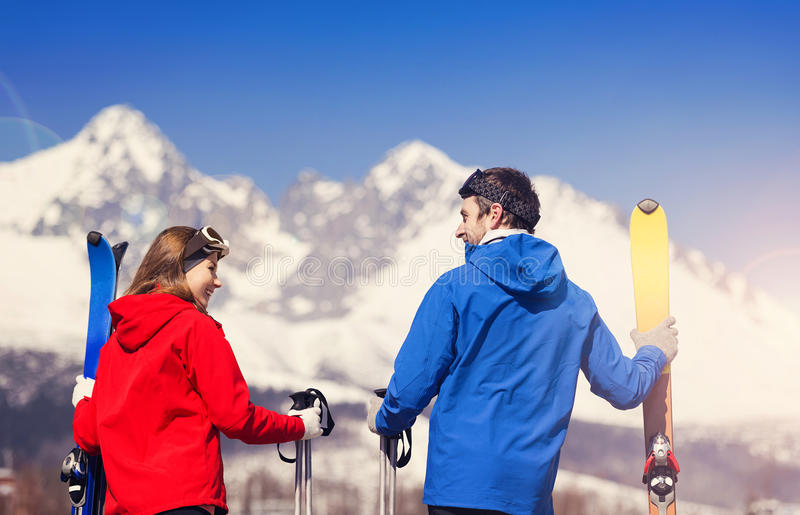 Young couple skiing. Outside in sunny winter mountains stock photo