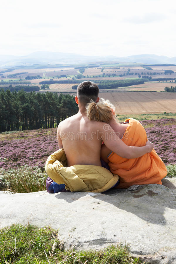 Young Couple In Sleeping Bags Admiring View royalty free stock image