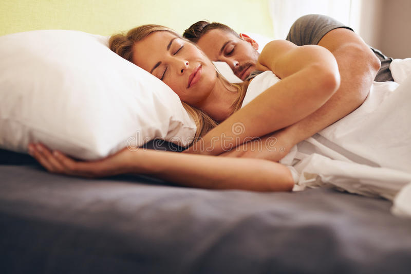 Young couple sleeping embraced royalty free stock photo