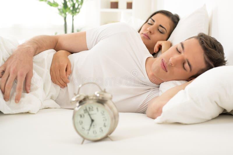 Young couple sleeping royalty free stock photos