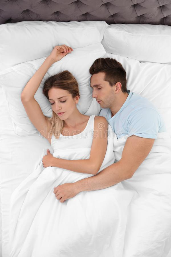 Young couple sleeping on soft pillows stock photo
