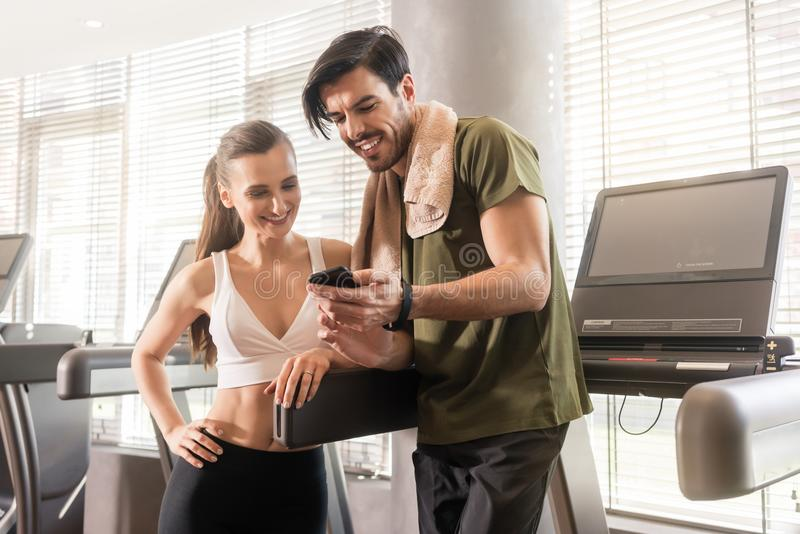 Young couple smiling while communicating on the mobile phone dur stock photos