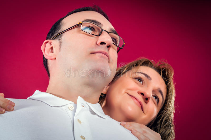Young Couple Smiling and Looking Up royalty free stock images