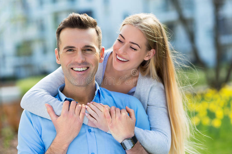 Young couple smiling outdoors stock photos