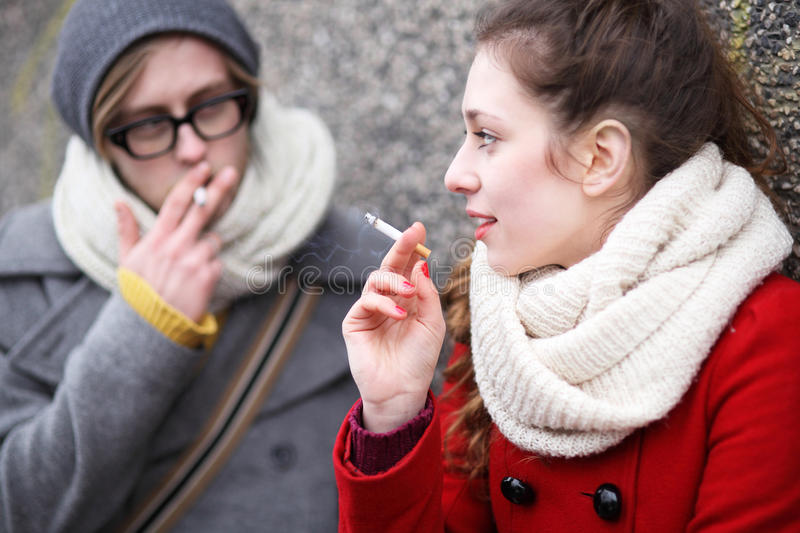 Download Young couple smoking stock photo. Image of smoker, beanie - 29526302