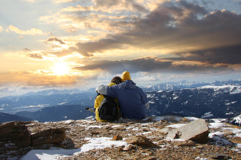 Young couple in snow mountains royalty free stock image