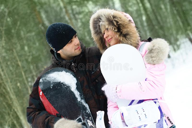 Download Young Couple With Snowboards Stock Image - Image of cheerful, outside: 8098379