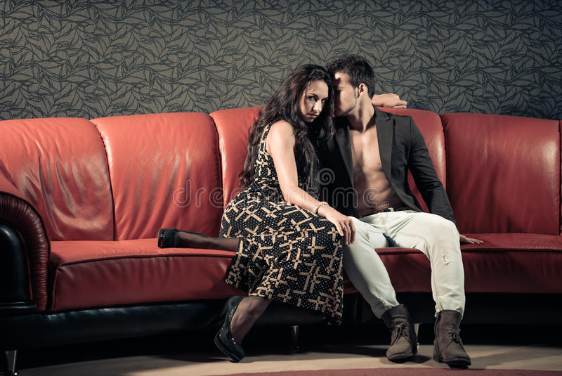 Young Couple On A Sofa Stock Photo