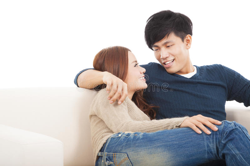 Young Couple On The Sofa In Love Royalty Free Stock Photos