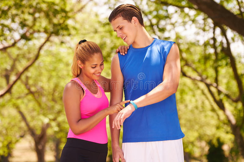 Young Couple Sports Training Fitness Fitwatch Steps Counter stock photo