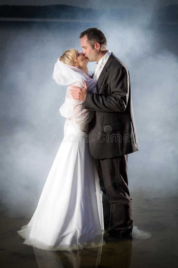 Young couple standing in a lake stock image