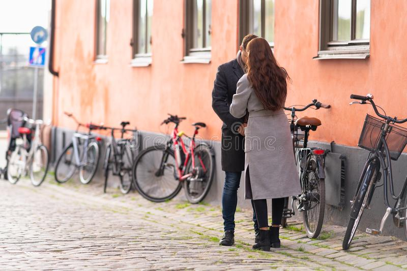 Young couple standing on a quiet urban street stock photo