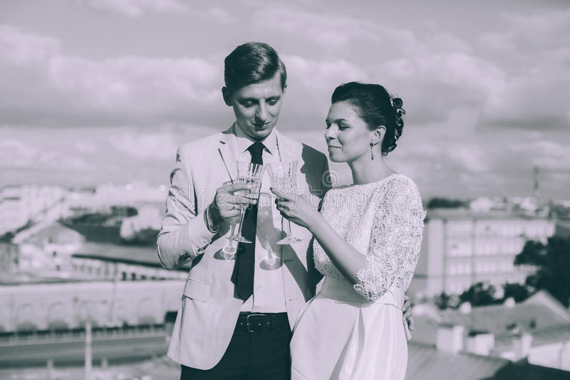 Young couple standing on the roof of the newly-married couple royalty free stock image
