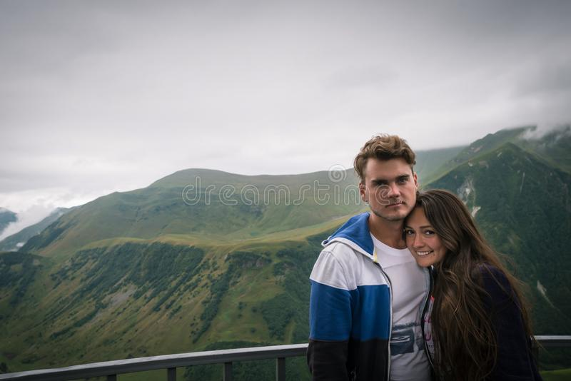 Young couple stands at observation deck stock photo