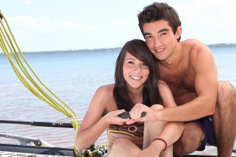 Download Young Couple Steering A Catamaran Stock Image - Image: 27915871