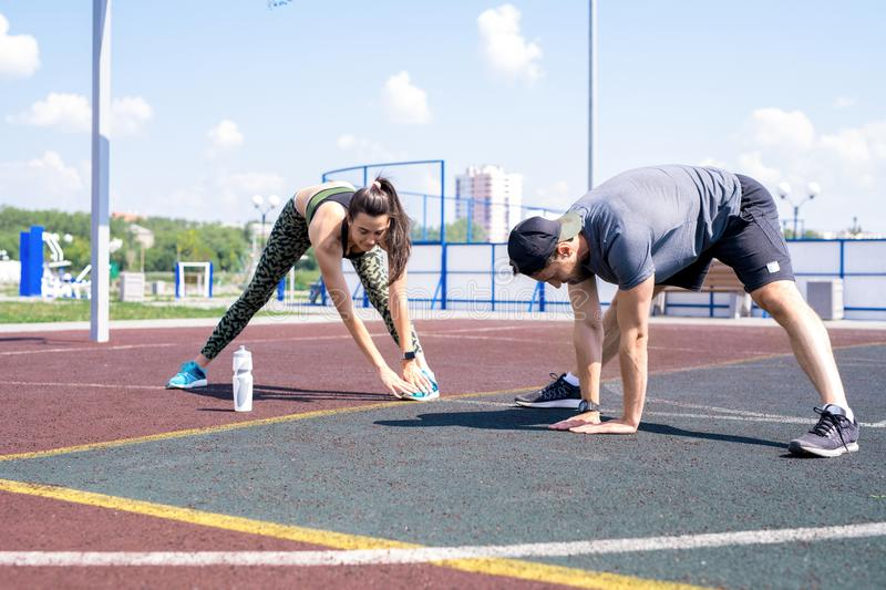 Young Couple Stretching Outdoors stock photo