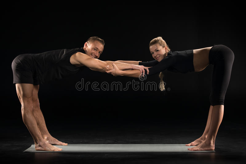 Young couple stretching stock image