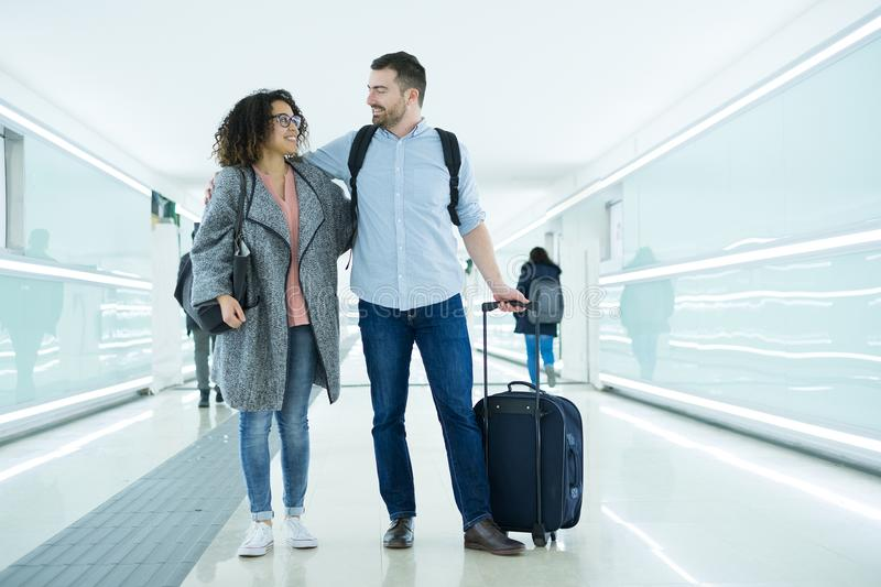 Young couple with a suitcase ready for travel royalty free stock image