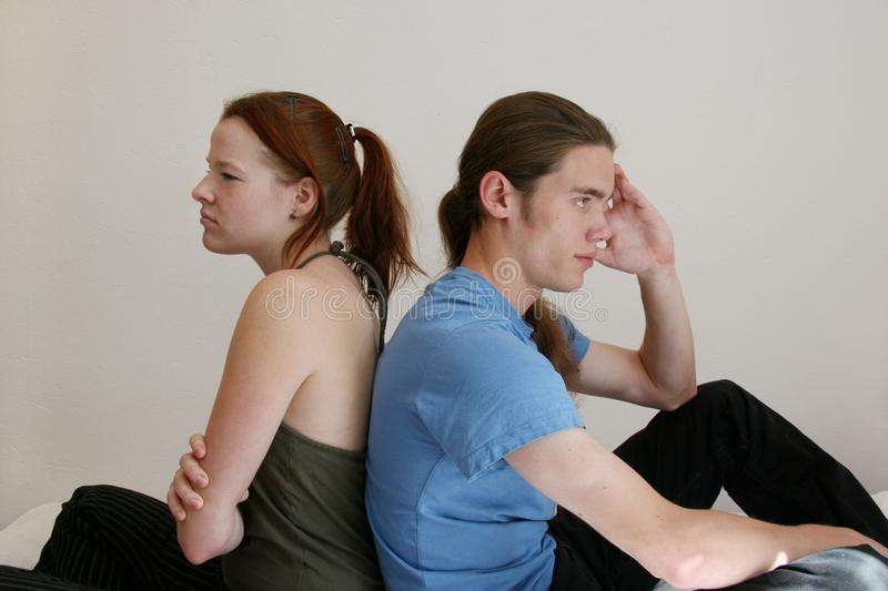 Young couple sulking stock photography