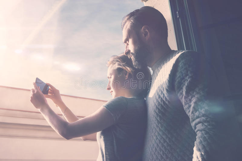 Young couple summer journey. Photo woman and bearded man making selfie mobile phone. Using contemporary smartphone stock images