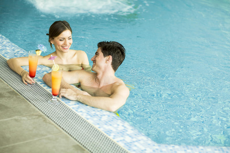 Young couple in the swimming pool stock photo