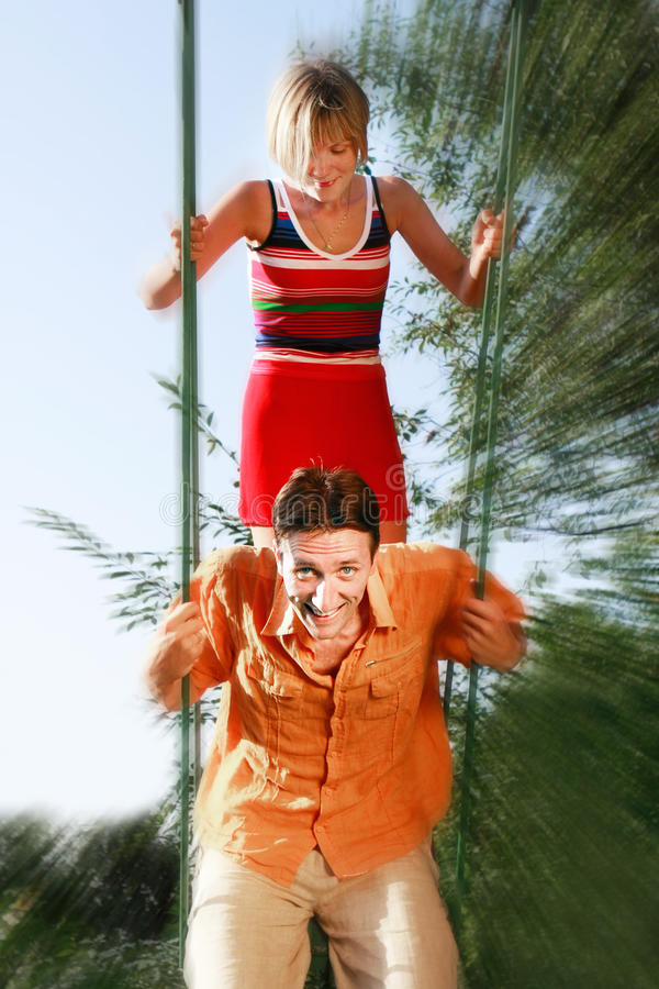 Download Young couple on swing stock image. Image of lifestyle - 10444767