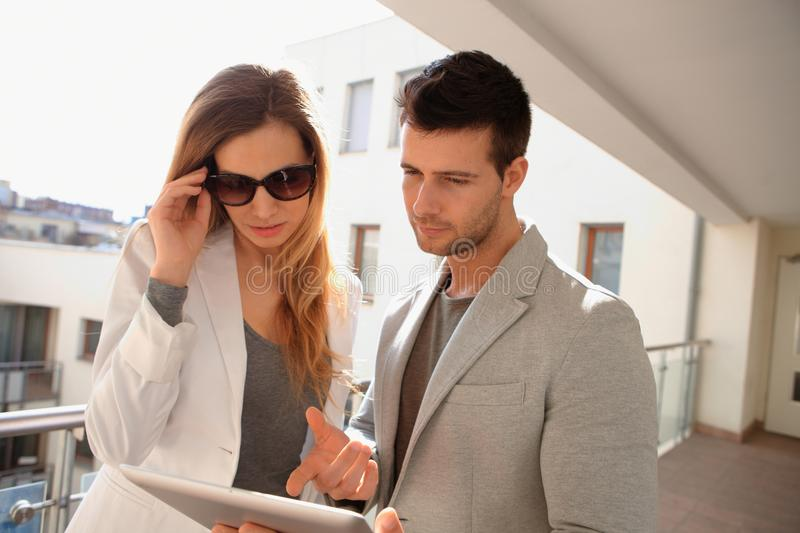 Young couple with tablet stock image