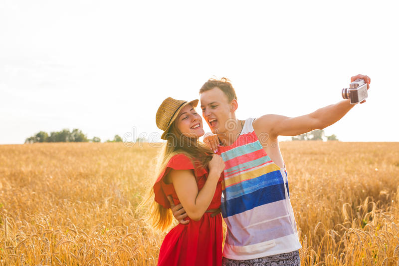 Young couple take photo by mobile phone.  stock image