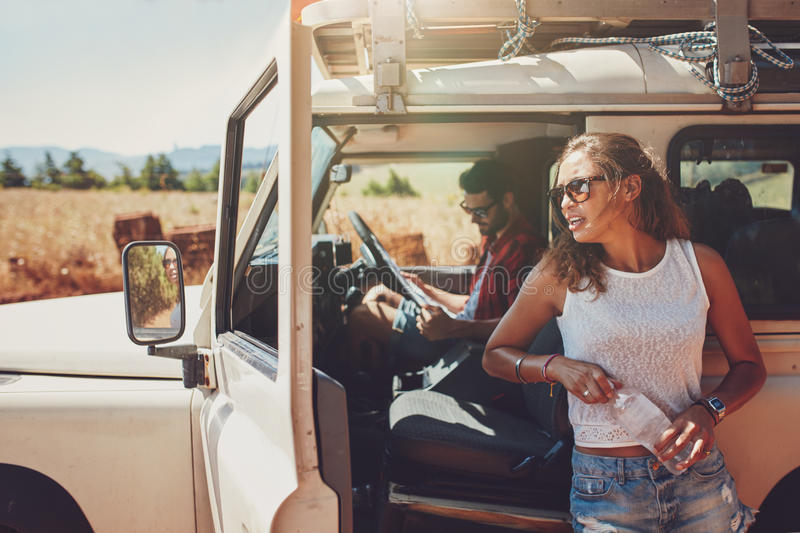 Young couple taking a break on road trip royalty free stock photography