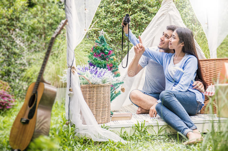 Young couple taking a photo in the park stock images