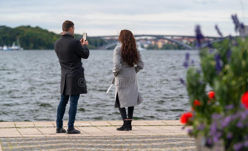 Young couple taking photographs while sightseeing stock photo