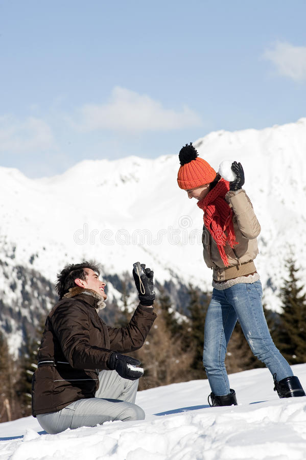 Download Young Couple Taking Photos On The Snow Stock Photo - Image of people, mountain: 27533480