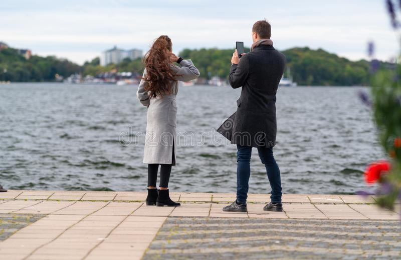 Young couple taking photos on their mobile phone stock photo