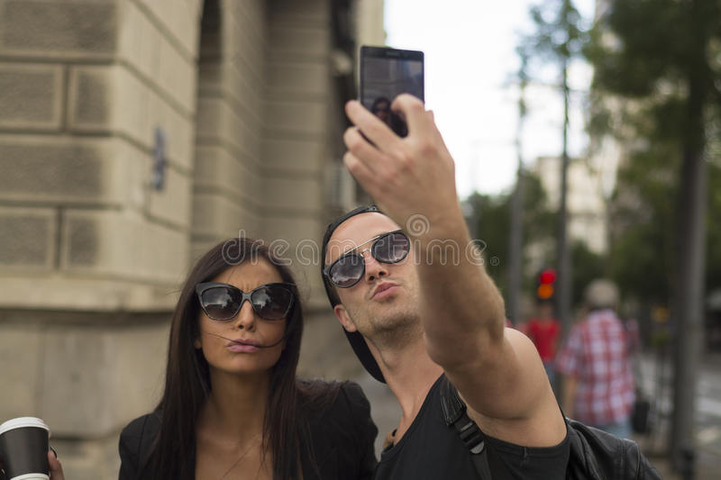 Young couple taking selfies royalty free stock photo