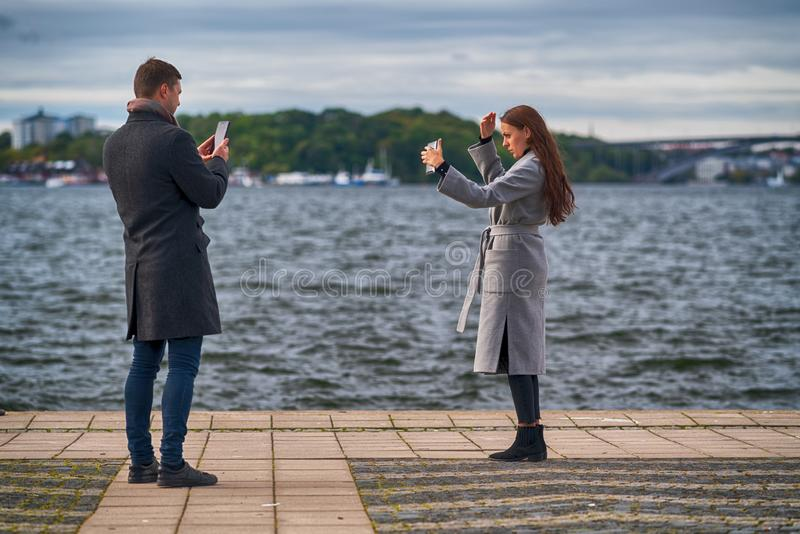 Young couple taking selfies on a promenade stock photography