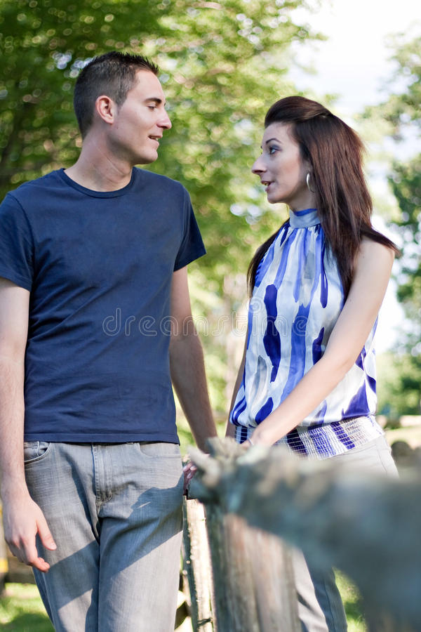 Young Couple Talking royalty free stock images